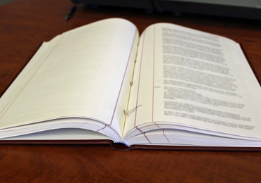 picture of a book of meeting minutes laying on a table