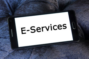 picture of cell phone with the word E-Services displayed on the screen