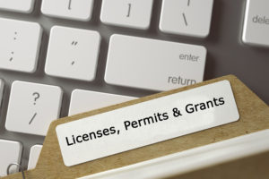 picture of file folder with the words Licenses, Permits & Grants displayed on the label